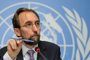 U.N. High Commissioner for Human Rights Jordan's Zeid Raad al-Hussein speaks during a news conference at the European headquarters of the United Nations in Geneva, Switzerland, Thursday, Oct. 16, 2014. Zeid drew comparisons between the Ebola outbreak and the Islamic State group Thursday, labeling them